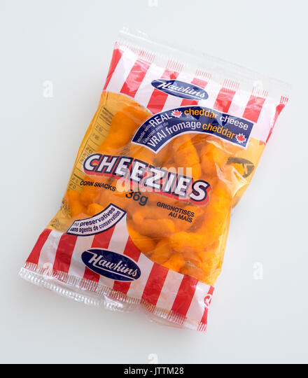 A bag of Cheezies, a brand of cheese puffs snack food made and sold in Canada by W.T. Hawkins Ltd. - Stock Image
