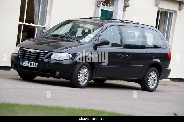 Black Chrysler Grand Voyager LX minivan - Stock Image