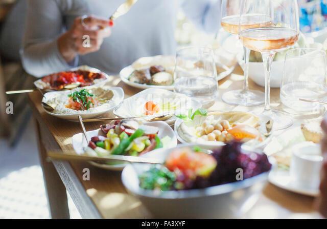Midsection of woman having meze at Lebanese restaurant - Stock-Bilder