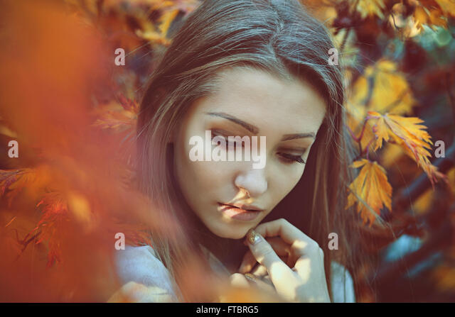 Beautiful woman portrait with sad colors . Innocence and purity - Stock-Bilder