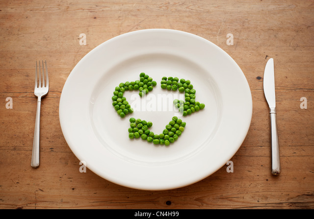 Peas in shape of recycling symbol - Stock Image