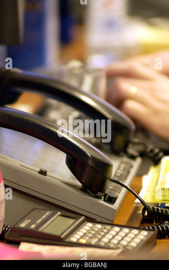 Photograph of trader the city desk business phones busy waiting - Stock-Bilder