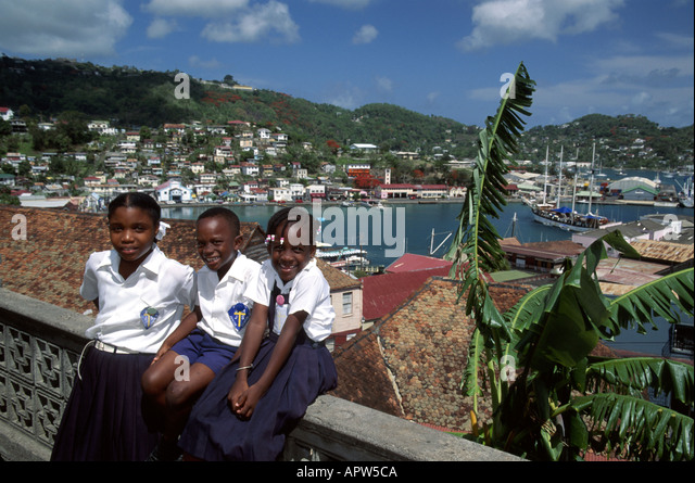 Grenada St. George's St. Mary's Catholic School students uniforms Carenage Harbor - Stock Image