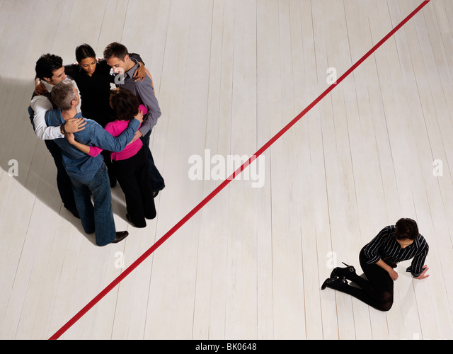 Business people divided by red line - Stock Image