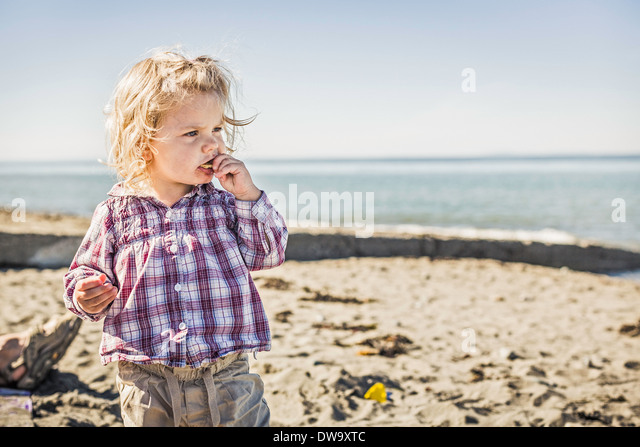 Baby girl on beach, Port Townsend, Washington, US - Stock Image