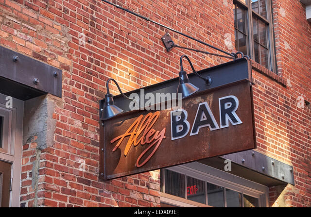 Alley Bar sign in 'The Alley', in Montgomery Alabama's premiere entertainment district. - Stock Image