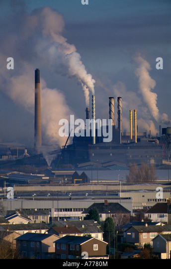 belching smokestacks pollution carbon emissions greenhouse gasses Avonmouth England UK - Stock Image