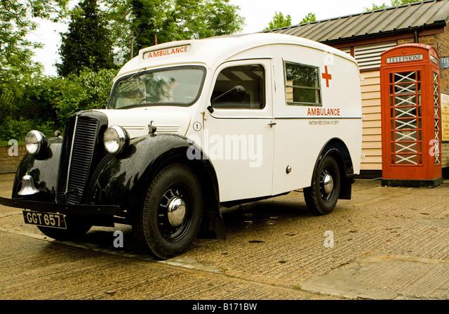 Old Fashioned Ambulance and Telephone Box - Stock Image