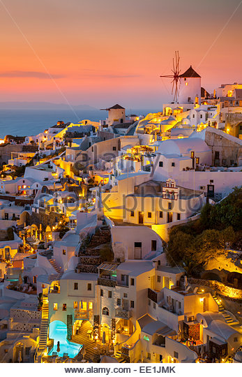 Windmill and traditional houses at sunset, Oia, Santorini (Thira), Cyclades Islands, Greek Islands, Greece, Europe - Stock Image
