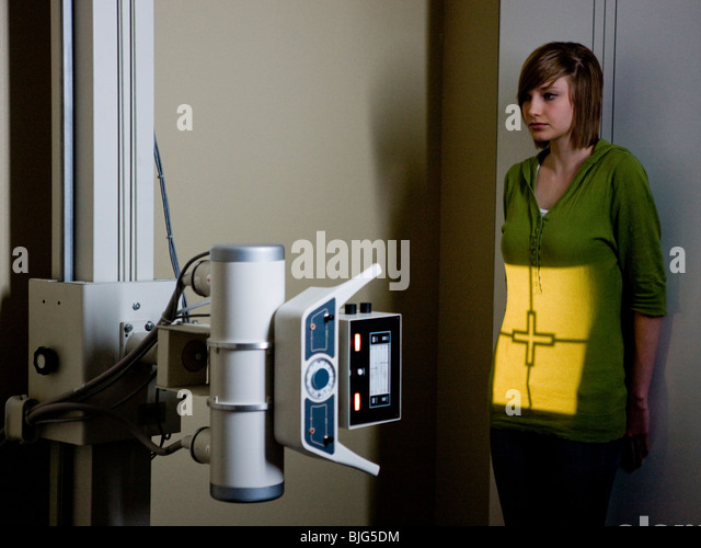 young woman having an x-ray taken - Stock Image