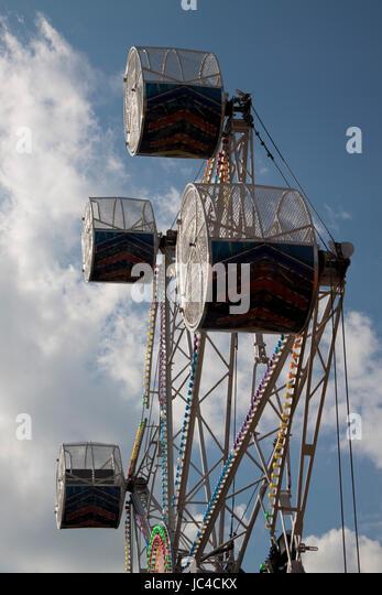 Passenger capsules of fun fair big wheel ride against the sky - Stock Image