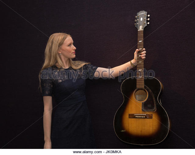 Knightsbridge,UK,12th December 2016,Laurel Kemp,senior sales co ordinator,holds a Epiphone FT79 Guitar owned by - Stock Image