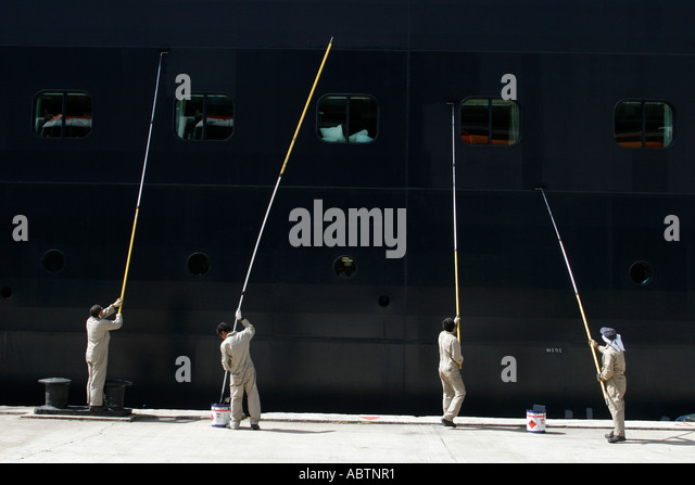 St. Thomas USVI Crown Bay Holland America Line ms Zuiderdam crew painting hull - Stock Image