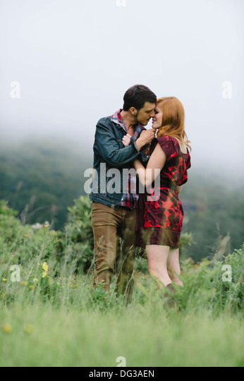 Romantic Couple About to Kiss in Foggy Field - Stock-Bilder