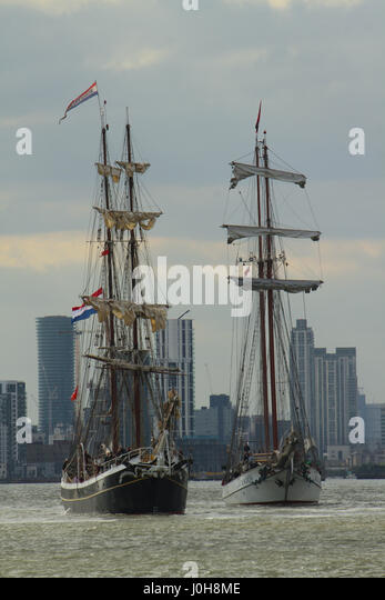 London, United Kingdom - April​ ​13: Two tall ships sail towards Woolwich Arsenal Pier during the 2017 Tall Ships - Stock Image