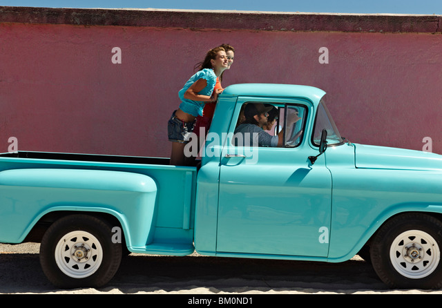 5 young people traveling in pickup truck - Stock-Bilder