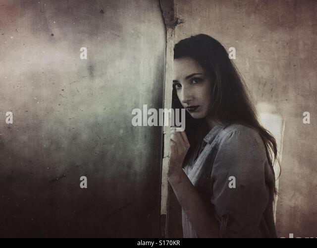 Sad woman by the window - Stock-Bilder