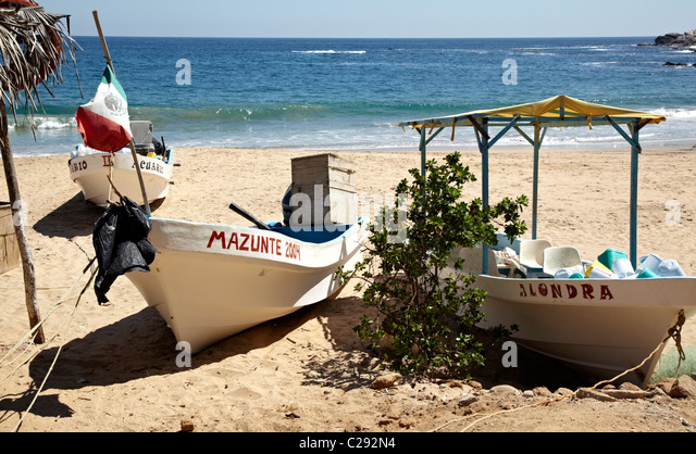 Fishing Boat On The Beach Mazunte Oaxaca State Mexico - Stock Image