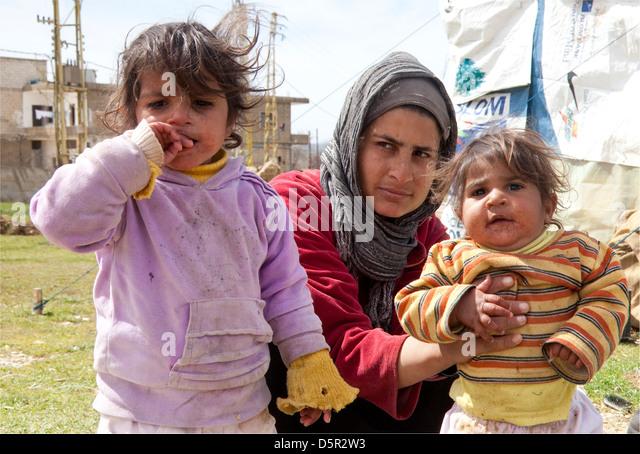 Syrian refugee family, near Bekaa Valley Lebanon - Stock Image