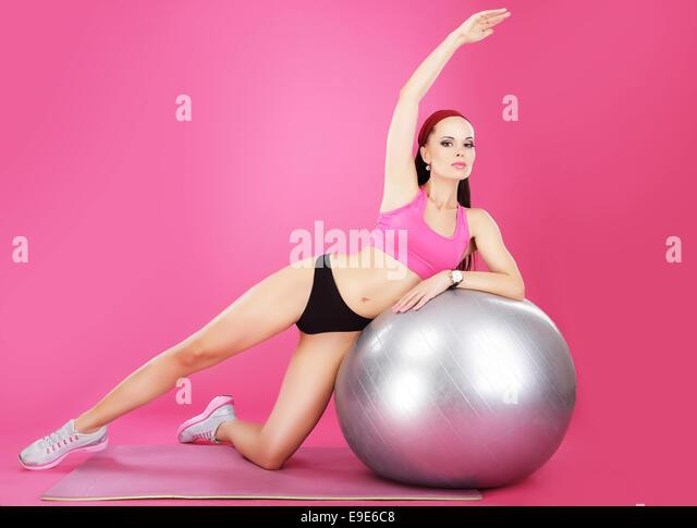 Aerobics. Sporty Woman on Fitness Ball Exercising - Stock Image