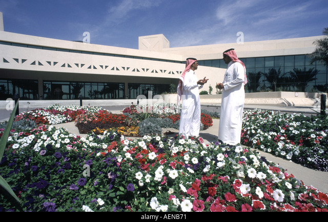 Saudi Arabain telecommunications workers in front of office complex in Riyadh Saudi Arabia - Stock Image