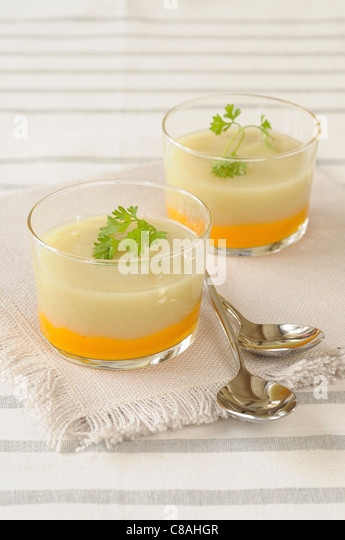Two-colored carrot and cauliflower-fennel soup - Stock Image