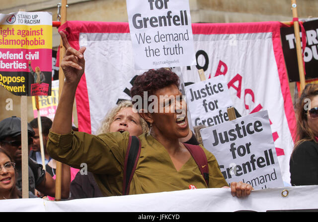 London, UK - 1 July 2017 - A demonstrator shouts  'Justice for Grenfell' ahead of the Tories Out march on - Stock Image