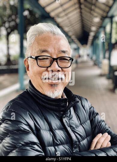Portrait of an older man in Hong Kong - Stock Image