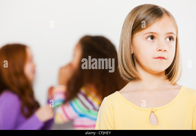 One girl excluded from other girls - Stock Image