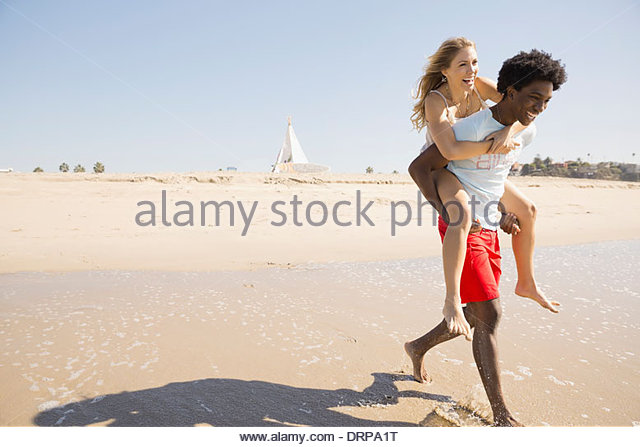 Couple spending time at the beach - Stock Image