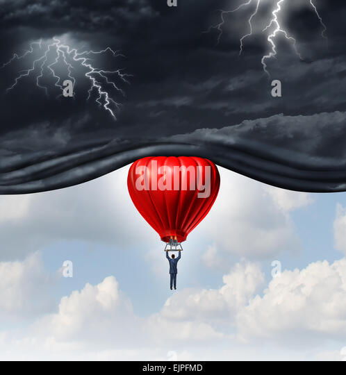 Positive outlook and recovery concept as a person or businessman riding a red hot air balloon lifting the dangerous - Stock-Bilder