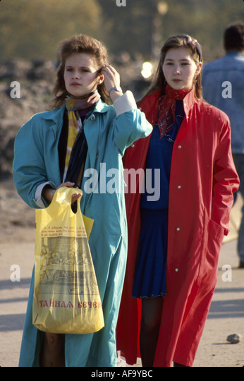 Latvia Riga fashionable females shopping pedestrians residents coats - Stock Image