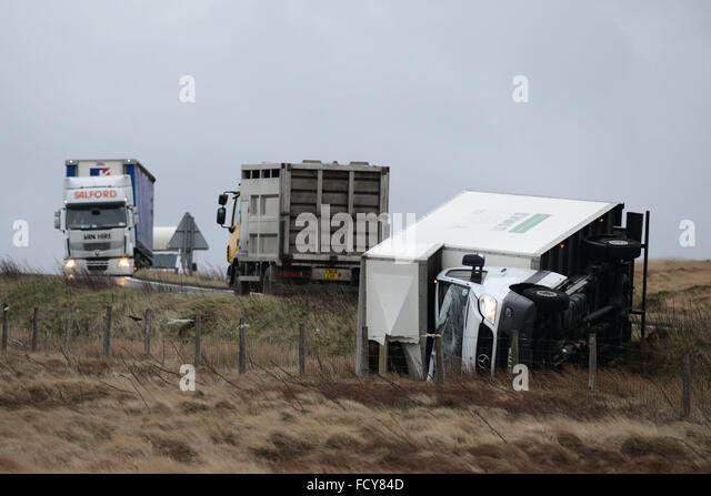 A Lorry blown over in strong winds on the A628 Woodhead Pass, near Dunford Bridge, West Yorkshire. © Scott - Stock Image