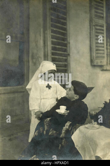 Boy and girl playing wounded and nurse, Italy - Stock Image