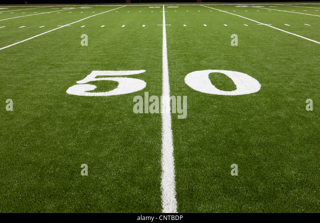 Fifty yard line on football field - Stock Image