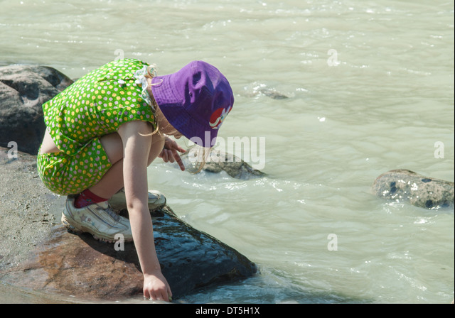 young-girl-crouched-along-the-athabasca-