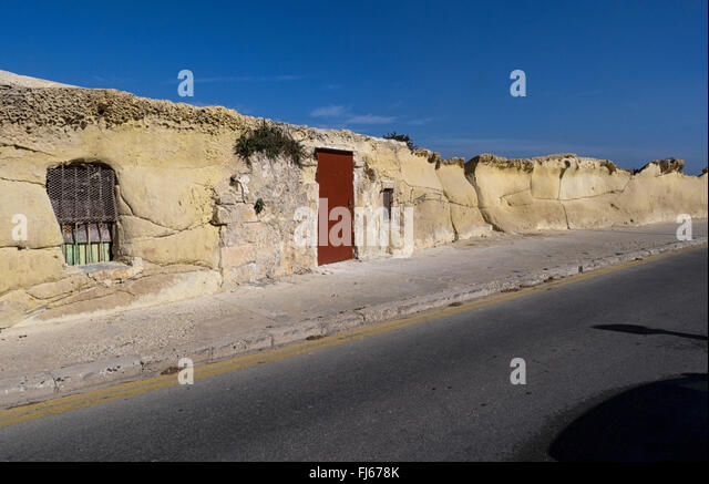 A hut carved out of the sandstone on the shore at Valletta, Malta - Stock Image
