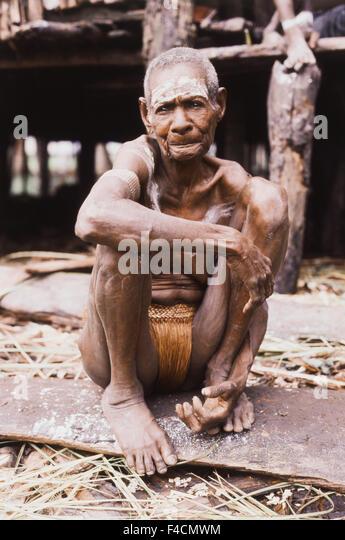 Indonesia, Irian Jaya, Native man sitting. (Large format sizes available) - Stock Image