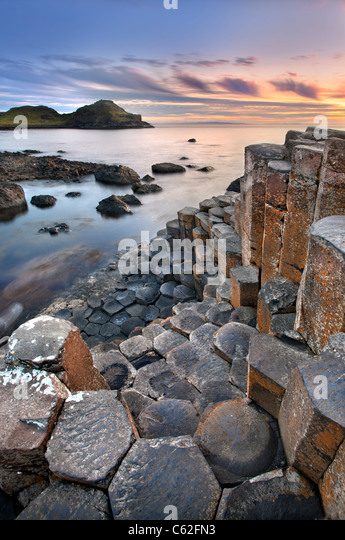 Giants causeway captured at sunset - Stock Image