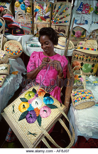 Bahamas New Providence Nassau Straw Market makes souvenir baskets - Stock Image