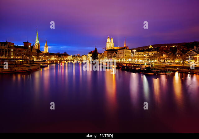 Zurich skyline and the Limmat river at night - Stock Image