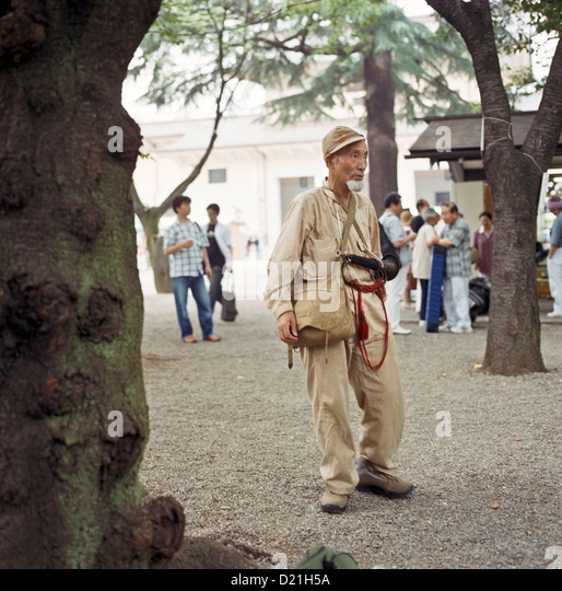 A man dressed in Imperial Japanese Army uniform at the Yasukuni Shrine in Tokyo, Japan - Stock Image