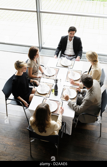 Business people having lunch together - Stock Image