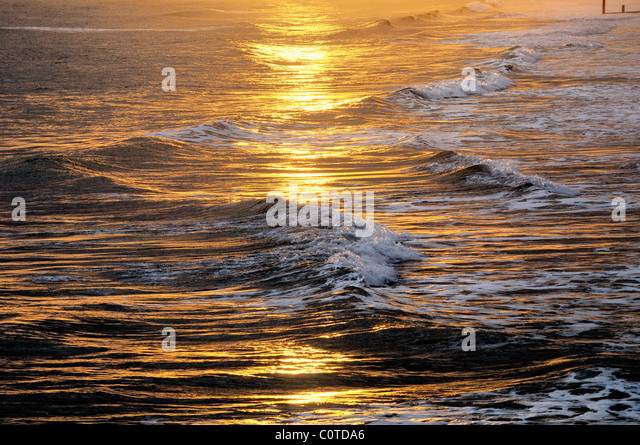 Winter sunlight on waves,Bournemouth - Stock Image