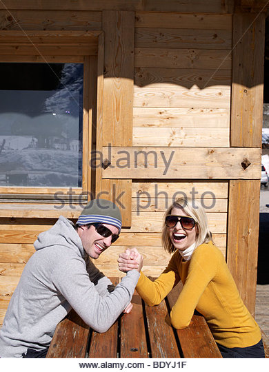 man and woman arm wrestle - Stock Image