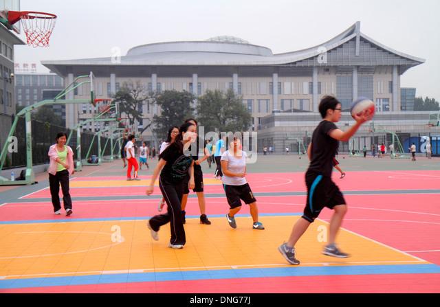 Beijing China Haidian District Peking University PKU Beidà higher education campus Asian woman teen girl friends - Stock Image