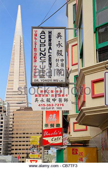 California San Francisco Chinatown ethnic neighborhood Clay Street business sign Chinese bilingual kanji acupunture - Stock Image