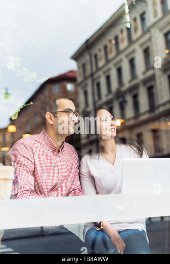 Sweden, Uppland, Stockholm, Man and woman sitting in cafe - Stock-Bilder