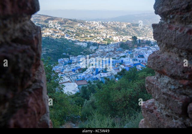 View of blue city of Chefchaouen at rising from fortified wall door. Morocco - Stock Image