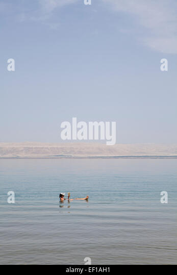 Relaxing in the dead sea. - Stock Image